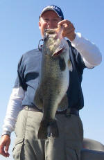 Pro Guide Tom Redington with a bass weighing almost 8 lbs