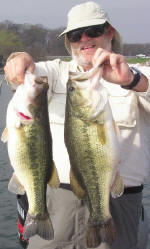 Ron Reid with a 5 and a 8 lb'er caught 3-7-06 fishing with Pro Guide Tom Redington