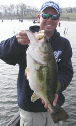 Pro Guide Tom Redington with a bass over 8 lbs.