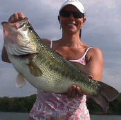 Ruth Diautos with a trophy bass she caught while fishing with Pro Guide John Tanner.