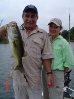 Alfredo also caught this bass weighing 6 lb 8 oz. Pictured also is wife Vannesa, who had never been fishing before in her life, caught 6 bass in the morning all between 4 1/2 and 5 pounds, two bluegills and several small channel catfish.