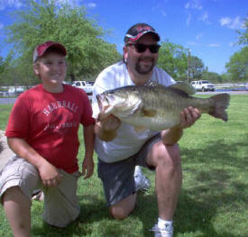 This HAWG was caught 4-7-06 at Lake Fork. It was my son's 16th B-Day! Dad caught it on a white jig in 1 foot of water. She weighed in at 11.85, 27 1/4 inches, and released back in at Lake Fork Marina! We caught a total of 9 fish, all 3 to 11 lbs!!!!! Happy Birthday to Jordan Lane, and dad Matthew Lane from North Richland Hills TX!!!
