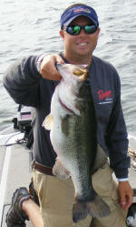 Pro Guide Tom Redington with a 7.5 lb largemouth that came on a Mega Weight Jig.