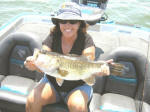 Candi England with a nice bass caught while fishing with  Pro Guide Marc Mitchell.