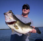 Jeff Delaughter from Tulsa OK. with a bass weighing 9 1/2 pounds caught fishing with  Pro Guide John Tanner.
