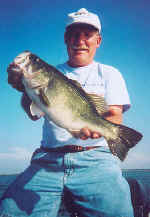 Willard Harper from Dallas, TX with a nice Lake Fork bass caught 6-30-03