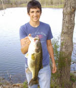 Jordan Liston, 15 years old, from Pearland, Texas was on a spring break fishing trip when he caught and released this bass, as well as the male, off of its nest on March 15, 2007. The bass was 25 inches long and its girth was about 19 inches.
