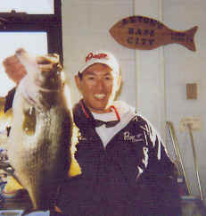 Omori displays a 9 lb. lake fork bass caught January 6, 2002