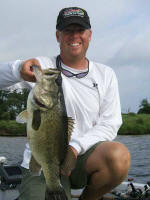 Pro Guide Tom Redington with a nice Lake Fork bass  caught on a black/brown/amber Lake Fork Tackle jig