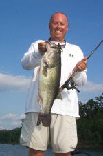 Pro Guide Tom Redington  with a 9 lb. bass caught on Carolina rigged Lake Fork Baby Creature.