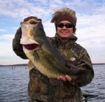 Sandy Cariker with a big bass she caught on a red rattle trap