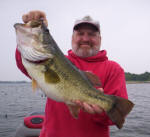 Scott Ames from Boston, Mass. with an 8.25 lb bass he caught with  Pro Guide John Tanner on 4/26. He caught this hog on a Cannibal by www.grandebass.com.