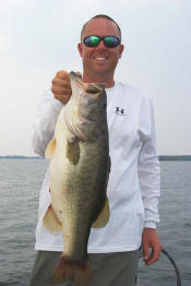 Pro Guide Tom Redington  with a 7 lb 9 oz bass caught on Carolina rigged Lake Fork Baby Creature.