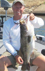 """Pro Guide Tom Redington  with another bass caught on Carolina rigged Lake Fork Baby Creature. This one-eyed measured a whopping 25-3/4"""" and came in right at 10 lbs"""